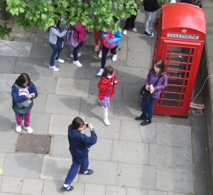 Tourists and telephone box
