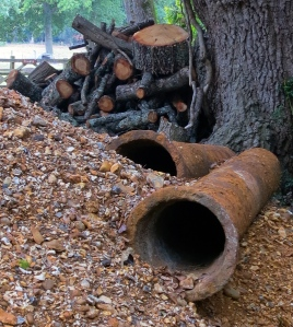 Gravel, pipes, and logs
