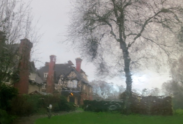 Castle Malwood Lodge through wet windscreen