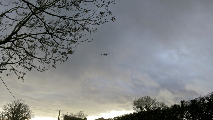 Helicopter in threatening sky