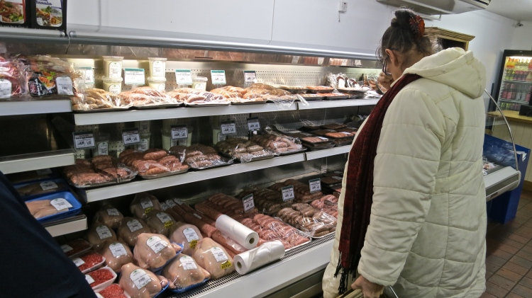 Jackie studying meat shelves