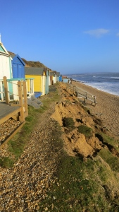 Cliff fall with beach huts