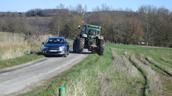 Tractor and car negotiating passage