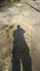 Shadow over pothole
