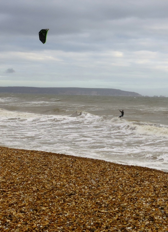 Kite surfer, shingle, Isle if Wight & The Needles