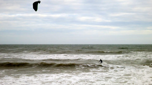 Seascape with kite surfer