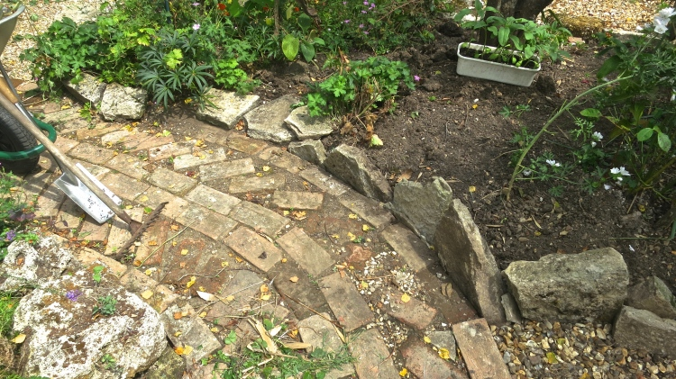 Oval bed brick path