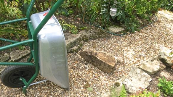 Stone and wheelbarrow