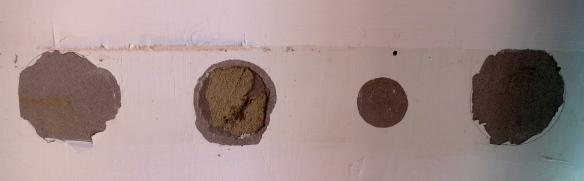 Wall behind teatowel hooks