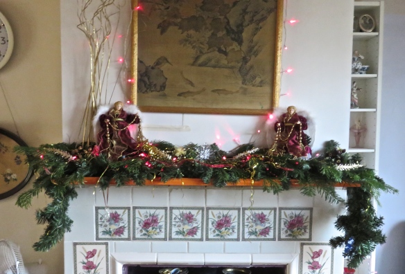Christmas decorations on mantlepiece