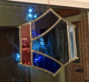 Christmas tree through stained glass