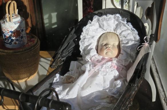 Doll in The Village Window