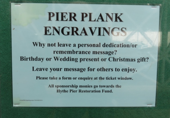Pier plank engravings sign