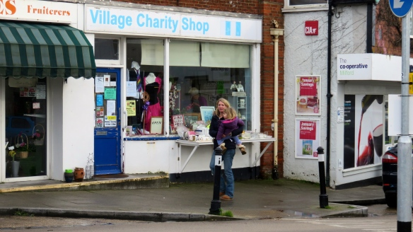 Woman and child outside charity shop