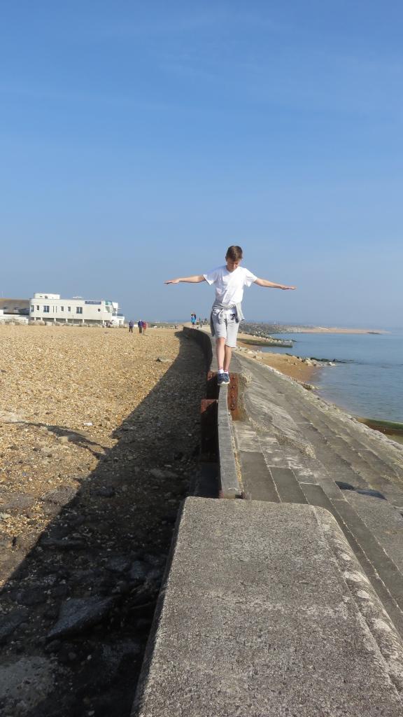 Boy (and Flo) on sea wall