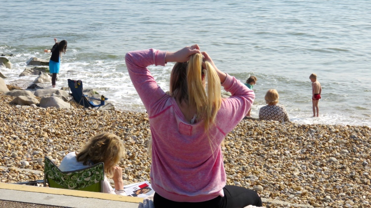 Girl brushing hair, Flo in background