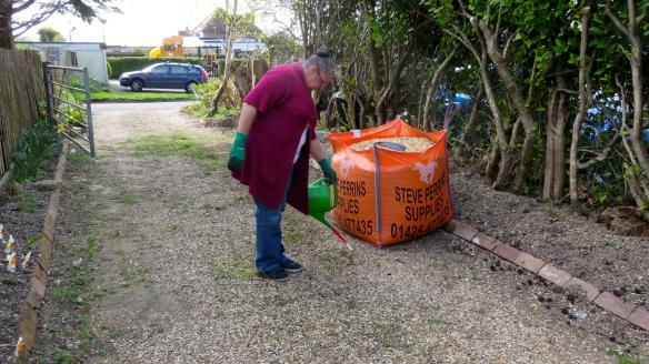 Jackie applying herbicide