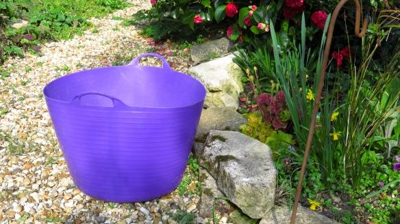Purple plastic bucket