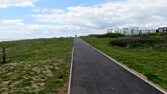 Footpath with walkers on horizon