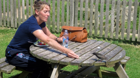Woman feeding starling
