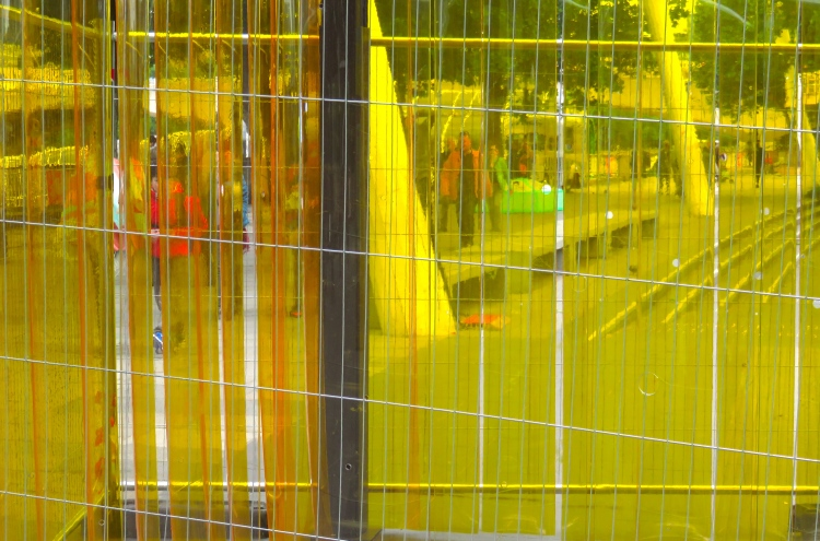 Yellow barriers and passers-by