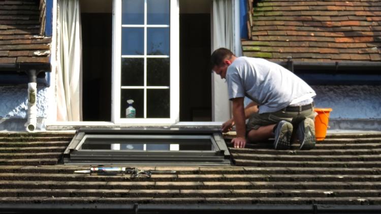 Mike repairing Velux window