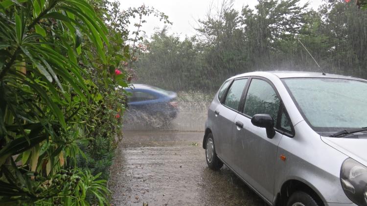 Rain thrown up by blue car