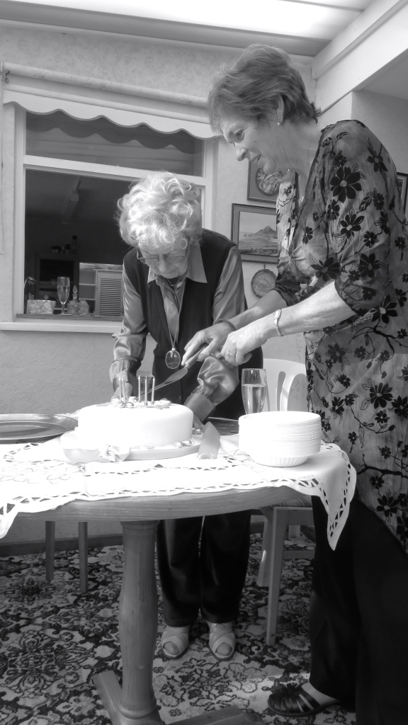 Daphne and Shelly slicing cake