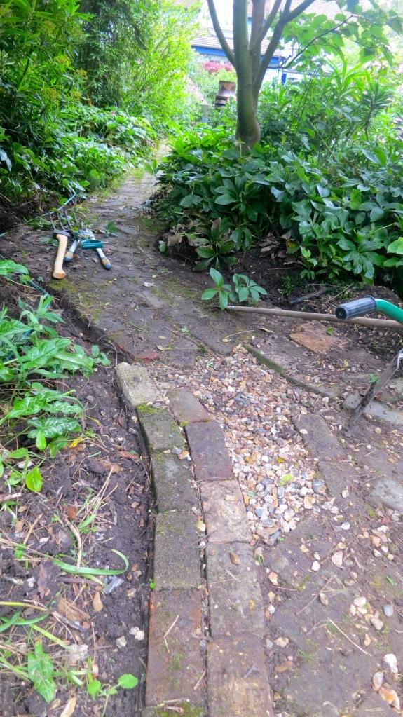 Brick path original being cleared