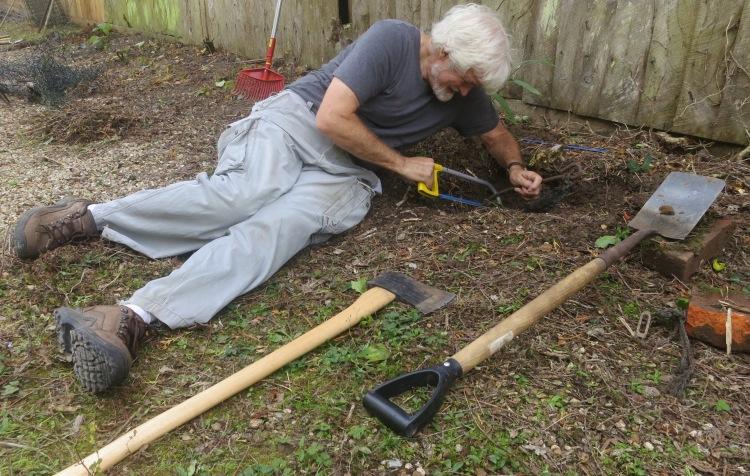 Derrick hacksawing iron stake