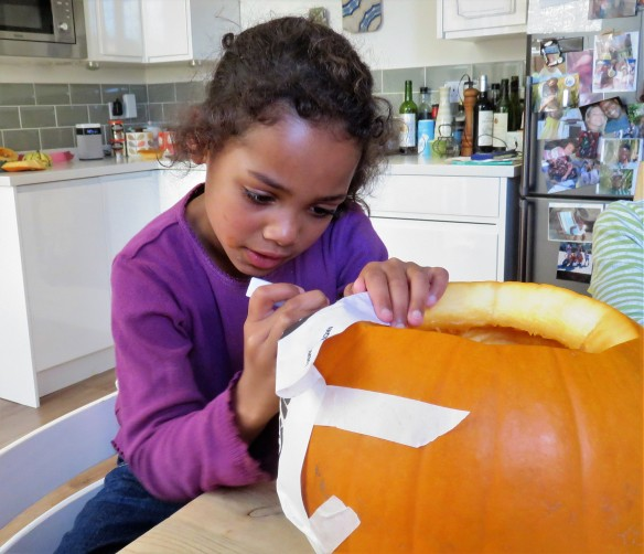 Imogen carving pumpkin 1