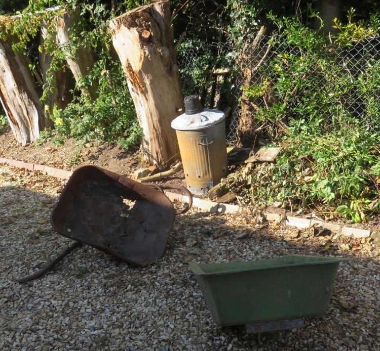 Incinerator and old wheelbarrows