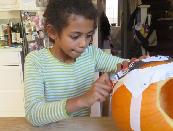 Jessica carving pumpkin