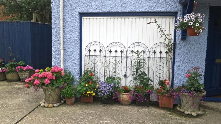Portable garden in front of garage