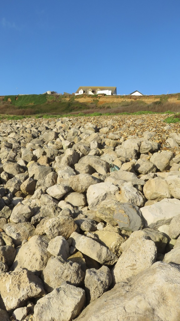 Buildings on clifftop and rocks