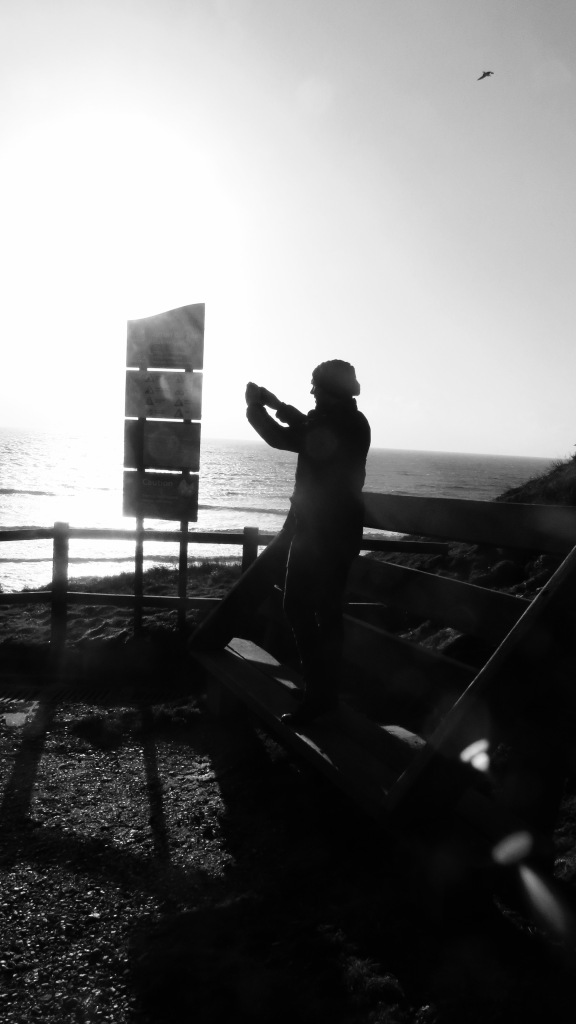 Silhouetted photographer