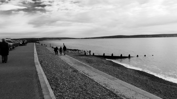 Walkers along beach 1