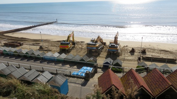 Diggers on beach