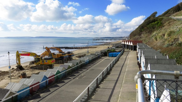 Diggers on beach and pier