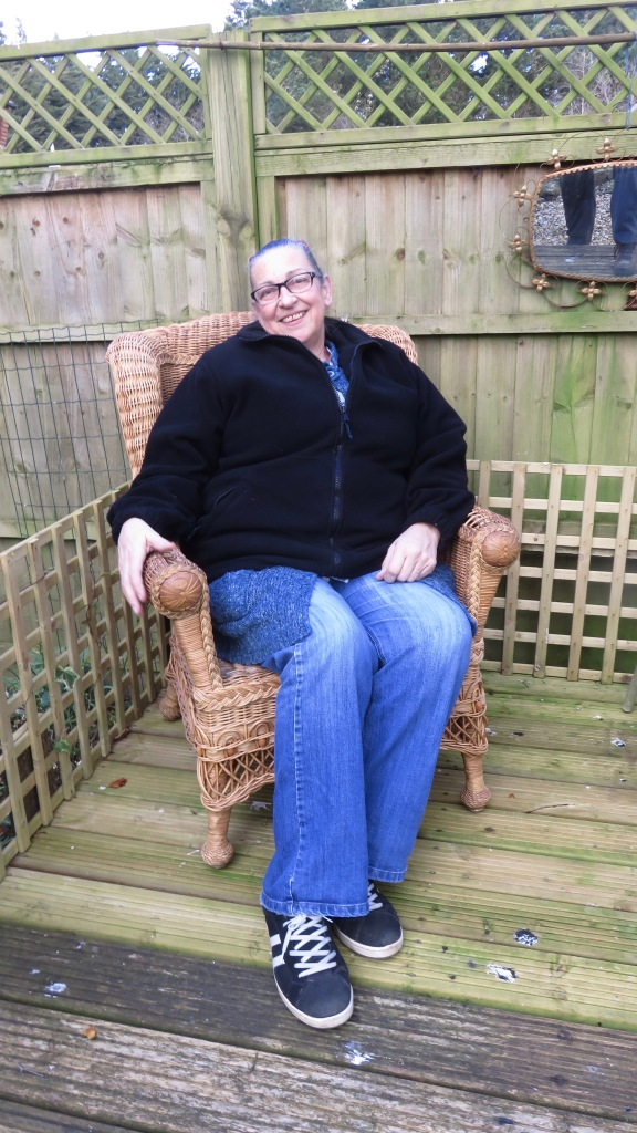 Jackie in cane chair