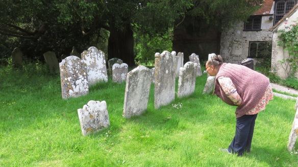 Jackie examining gravestones