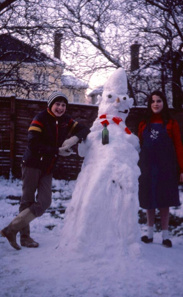 Matthew, Becky, and snowman 12.81