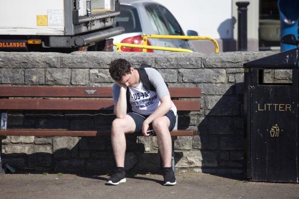 Young man on Mavis Robinson's memorial bench