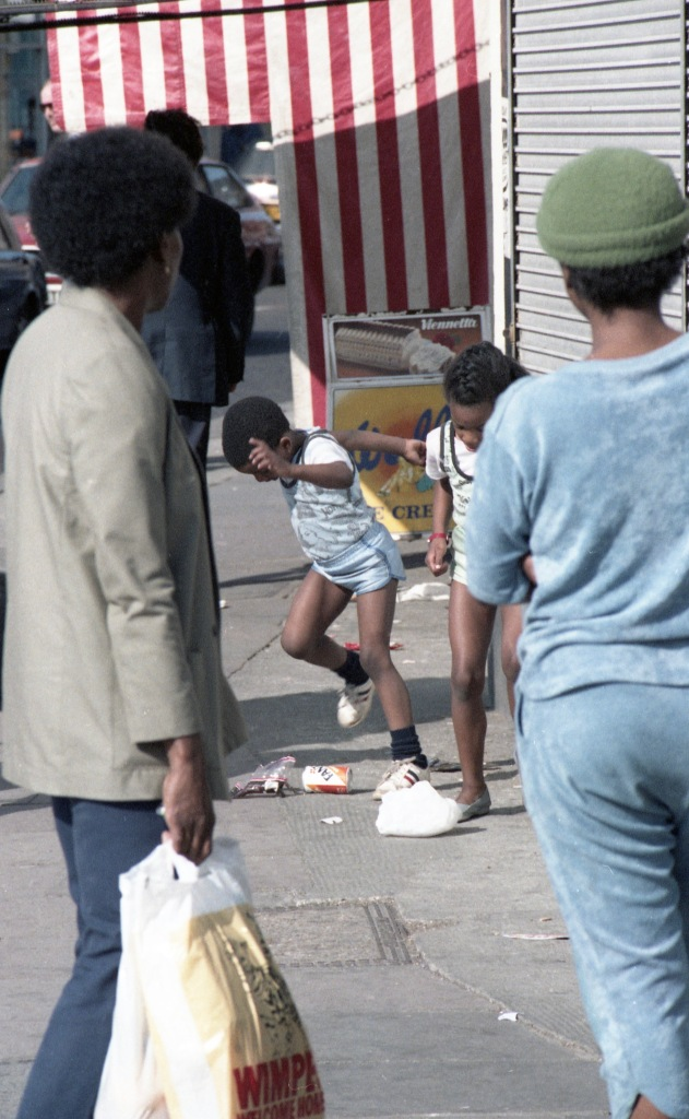 Boy and girl kicking cans 1984