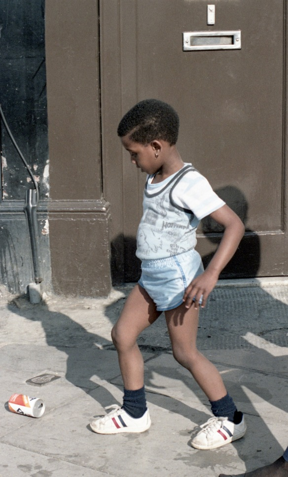 Boy kicking can 1984