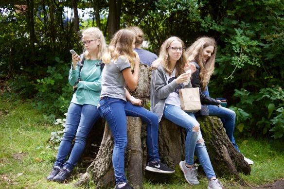 Girls on stump 1