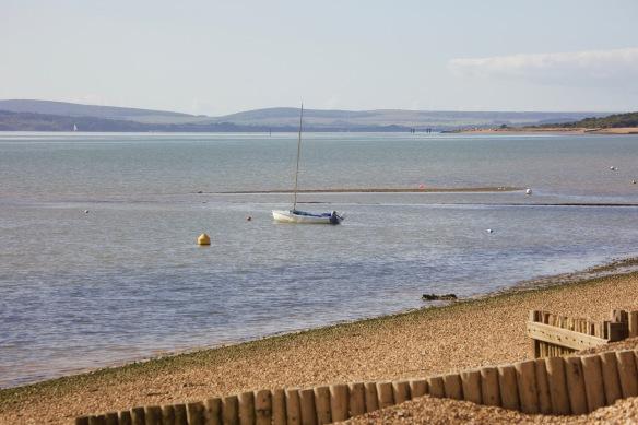 Boat moored near Calshot Beach