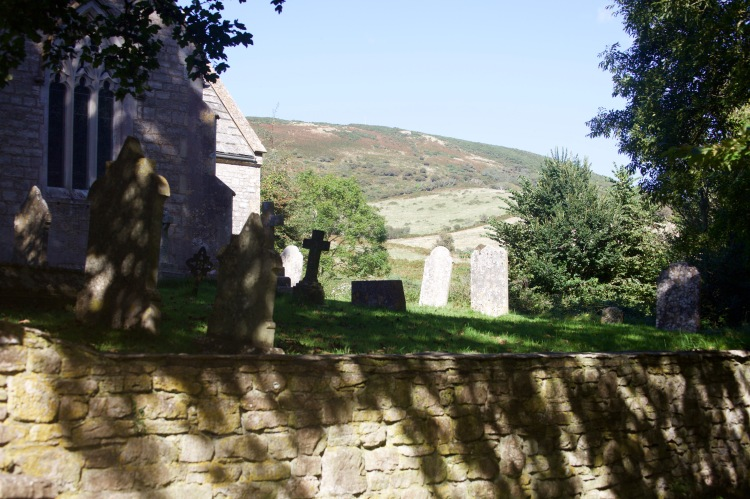 Hillside beyond church