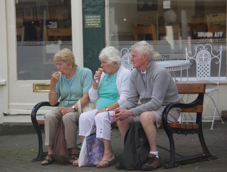 Ice cream eaters on bench