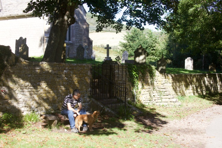 Man and dog outside church